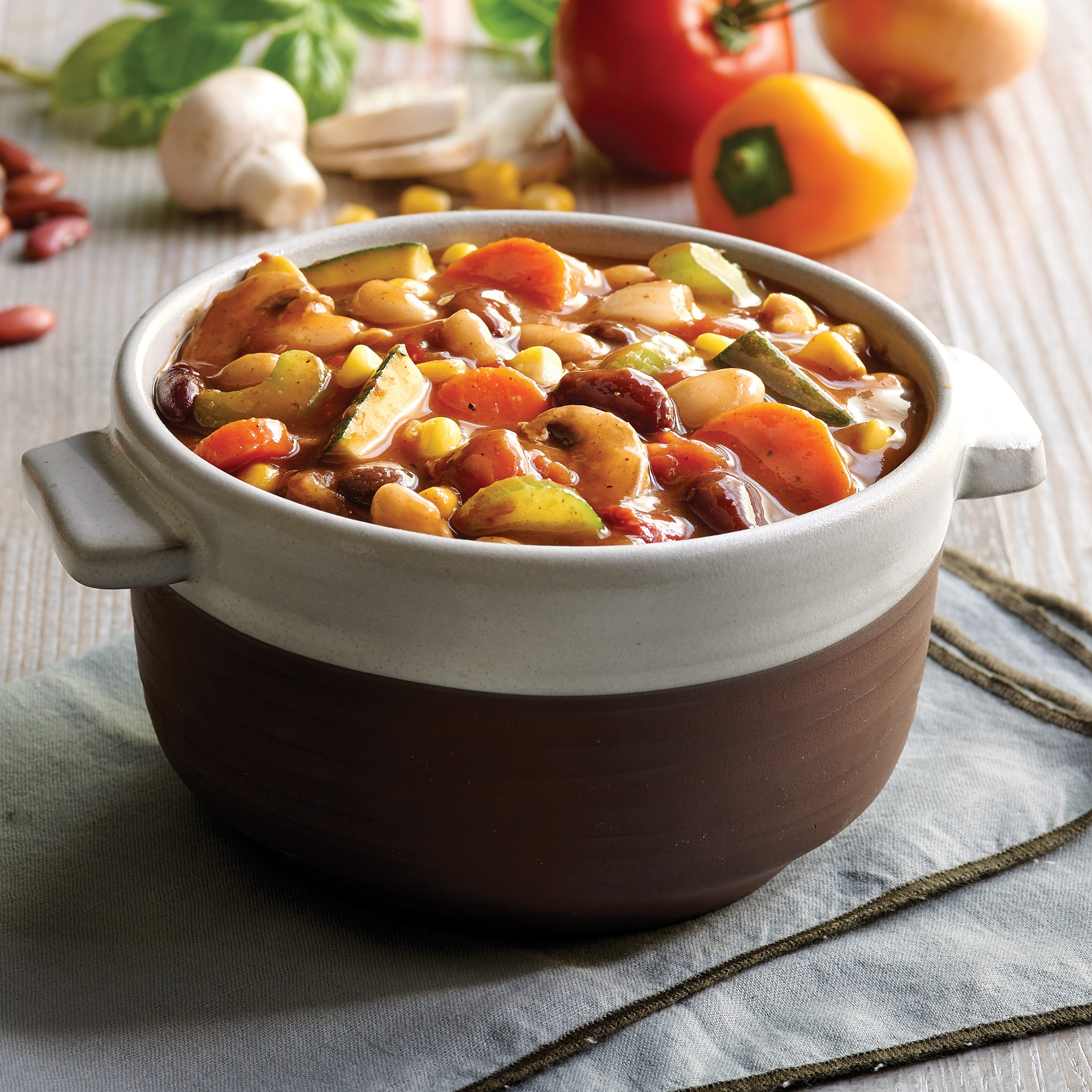 Bowl of foodservice Whitey's Frozen Chili Manufacturers Chipotle Garden Vegetable Chilii in a restaurant setting