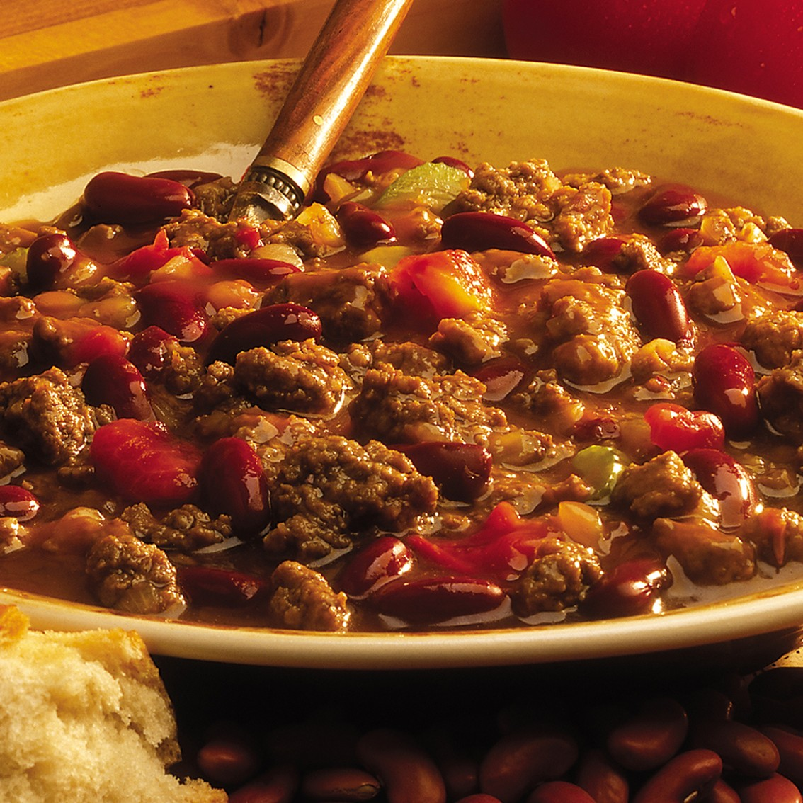 Bowl of foodservice Whitey's Frozen Chili Manufacturers Beef Chili in a restaurant setting